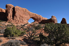 Grand - The Mighty Arch (Drriss & Marrionn) Tags: travel red sky cliff usa cloud mountain mountains nature rock clouds landscape utah sandstone skies arch outdoor roadtrip canyon moab blueskies mountainside archesnationalpark lasal crag northwindow naturalarch