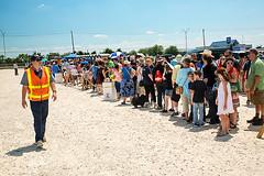 Long Lines (wyojones) Tags: texas deerpark houston sanjacintobattlefieldstatehistoricalpark sanjacintoday sanjacintobattlereenactment parking lines people wait frustration shelllot wyojones