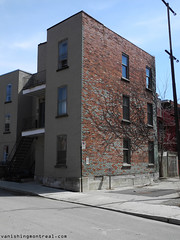 Exposed bricks on building on Richelieu (Vanishing Montral) Tags: history villedemontreal montreal histoire photography art architecture demolition disappearinghistory newconstruction