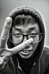 Manga-san Says Goodbye (filmbyhand) Tags: portrait blackandwhite nerd mystery pose tokyo glasses blackwhite student geek sigma s genius goodbye otaku hdr boywonder