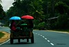 mode of travel (mithra srilanka) Tags: umbrella transport sunny srilanka roadway higway handtractor