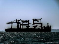 TIMBLO (Uddhav Gupta) Tags: ocean blue sunset sea vacation sun india holiday beach silhouette big ship crane goa 25 tanker