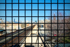 Into the Grid (Andy Marfia) Tags: city chicago abstract train fence grate grid iso100 pattern cta bokeh geometry platform tracks el l greenline westtown citiscape f38 11600sec d7100 1685mm