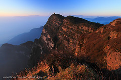 Emei Shan's Golden Summit and the Sea of Cloud at Sunrise (baddoguy) Tags: blue sunlight mountain horizontal fog outdoors photography nationalpark twilight nopeople illuminated unescoworldheritagesite naturereserve copyspace emeishan dramaticsky cloudscape clearsky mountainridge traveldestinations colorimage famousplace mountainpeak beautyinnature sichuanprovince goldcolored sunrisedawn atmosphericmood chinaeastasia