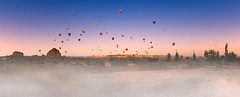 Dawn. Cappadocia, Turkey (Marji Lang Photography) Tags: morning travel sky panorama mist color heritage tourism horizontal misty fog turkey balloons landscape outdoors dawn earth fineart country trkiye foggy documentary atmosphere panoramic unescoworldheritagesite unesco turquie heartland photograph destination historical popular magical hotairballoons unescoworldheritage ballooning hittite turkish cultural turk cappadocia worldheritage touristic anatolia discover eurasia goreme hotairballooning kapadokya anatolian capadocia travelphotography rosevalley redvalley fairychimneys hatti hattusa travelinturkey gremenationalpark traveldestination centralanatolia skyballoons europeandasia katpatuka westernasia kappadoka  visitturkey easternthrace populartouristdestination turkeytourism worldsbeauty marjilang travelfavourite