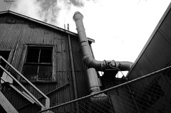 At the back of Alice's (stephen trinder) Tags: newzealand christchurch chimney blackandwhite building broken coffee monochrome architecture stairs fence landscape moody decay empty postoffice nz kiwi damaged derelict entry corrugatediron c1 aliceinvideoland postearthquake christchurchnewzealand stephentrinder stephentrinderphotography