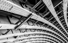 Let's Play Bridge - Explored (DobingDesign) Tags: city bridge urban blackandwhite london lines metal architecture vanishingpoint riverside steel curves perspective structure strong bolts underneath engineered sturdy spanning londonarchitecture abridgeoflondon