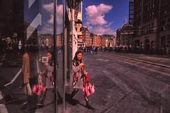 Leaving shop @ Amsterdam (PaulHoo) Tags: street city people urban woman holland color reflection film window netherlands amsterdam shop lady clouds analog nikon candid citylife streetphotography velvia fujifilm f5 25mm 2016 streetcandid