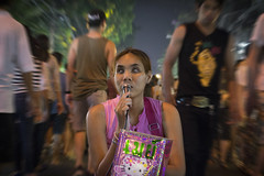 Steely Eyed (tylerkingphotography) Tags: city travel people motion girl lady night thailand photography eyes nikon southeastasia photographer blind market outdoor kingdom explore backpacking thai chiangmai 1855mm traveling amateur d3100
