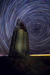 Railroad Grain Tower (Season of Fire) Tags: longexposure sky abandoned night dark stars landscape photography colorado nightscape space ngc sigma wideangle galaxy nightime astrophotography astronomy nightsky cosmos startrails polaris stargazing supershot canon60d starphotography