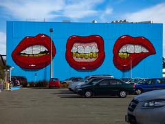 Kissing Cars (Steve Taylor (Photography)) Tags: city blue red newzealand christchurch woman white streetart art yellow wall lady mouth gold graffiti words mural spectrum teeth canterbury lips odd nz southisland cbd outline carpark tilt brilliant oiyou
