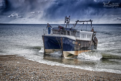 ADSC_7794 (Russell Bruce Photography) Tags: old sea people fish beach broken weather work boats coast town wooden seaside fishing surf waves decay south ships extreme working cliffs landing machinery oil beached british rusting hastings bulldozer