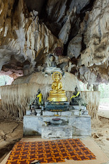 Image of Buddha in the cave (Evgeny Ermakov) Tags: travel tourism statue stone asian thailand religious outdoors temple gold golden ancient asia southeastasia image outdoor antique buddha buddhist traditional religion pray culture buddhism holy thai cave meditation southeast krabi touristic buddhistic tigercave tigercavetemple