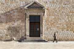 beware, the walls have eyes (cherryspicks (off for a while)) Tags: door morning light people woman building stone wall architecture person eyes croatia unesco monastery dubrovnik adriatic worldheritage franciscan