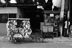 Before Going to Work (Maybe) (Purple Field) Tags: street bw film monochrome analog 35mm walking indonesia 50mm alley fuji kodak iso400 rangefinder jakarta neopan  f28 schneider retina kreuznach presto      iic         retinaxenon