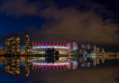 BC Place's Northern Lights Display decorated with an international flair. (Spencer Finlay) Tags: nightphotography reflection night vancouver cityscape flags falsecreek bcplace