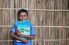 Education is the light!! (ashik mahmud 1847) Tags: blue boy smile kids book nikkor bangladesh d5100