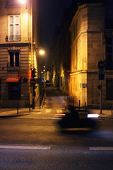 Paris (Jorkew) Tags: road street longexposure light people motion paris france streets tourism seine night canon de eos la movement alley noir traffic candid scooter artificial quay l motor frankrijk usm rue fr iledefrance f28 canonef2470mmf28lusm ef parijs quartier artificiallight monnaie laseine 2470mm 50d canoneos50d francetourism quartierdelamonnaie