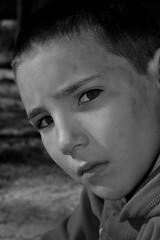 Benji (prestigerard) Tags: portrait canon nikon nb yeux triste enfants d200 rue regard allure garcon visages d40 timide objectifs d300s