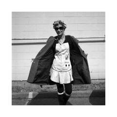 The Beauty Process (EvenShift///3) Tags: blackandwhite bw woman sun brick 120 6x6 film sunglasses lady analog mediumformat hair square unitedstates boots kentucky ky cigarette coat makeup skirt convention louisville 19 ilford yashica liquorstore curlers hp5plus yashicamat124g ilfosol3