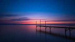 Dawn (jarnasen) Tags: longexposure morning blue sky copyright orange lake colour reed water clouds landscape dawn pier twilight nikon sweden outdoor jetty tripod smooth himmel explore le sverige colourful nikkor scandinavia scandinavian stergtland firesky ndfilter tvrskogsudde roxen lakescape explored d810 leefilters nd10 ekngen nordiclandscape bigstopper 1635mmf4 jarnasen