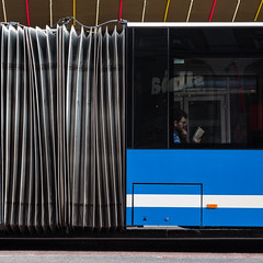 Turning Pages (Markus Jansson) Tags: street reflection bus sign square reading book neon traffic stockholm pages candid letters floating squareformat