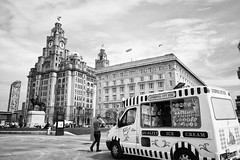 Time for ice cream (cathbooton) Tags: city blackandwhite clock sunshine liverpool waterfront outdoor may wideangle icecream midday canoneos 18mm liverbirds liverbuilding cunardbuilding canonusers