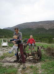 playing on farm machinery (squeezemonkey) Tags: playing france outside countryside castiron mower bunkhouse farmmachinery alauzon