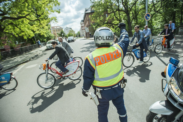 Policeman strategically positioned to ensure smooth biking