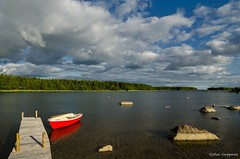 The red boat (- Man from the North -) Tags: trees red sea summer sky seascape water clouds finland photography boat rocks cloudy jetty naturallight wideangle scene westcoast classicboat vintageboat samyang gulfofbothnia nikond7000 samyang14mmf28 terhi375