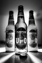 Harpoon UFO Pumpkin Beer (M-M_Photo) Tags: lighting november autumn party blackandwhite bw food 3 cold fall halloween beer drunk contrast digital canon dark festive pumpkin eos mono three photo cool scary october bright bottles artistic drink jackolantern ominous connecticut flash harvest drinking picture newengland highcontrast ct monotone monochromatic fav20 highlights ufo september liquor cap alcohol trinity brewery booze 5d harpoon dslr product triplet coldweather brew len bottlecap strobe harpoonbrewery lenses lightrays greyscale beerbottle photog productphotography offcameraflash craftbeer fallfoods partyfoods 5d3 5diii