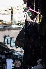 (Georgina ) Tags: sunlight athens greece dresses wires shops bazaar