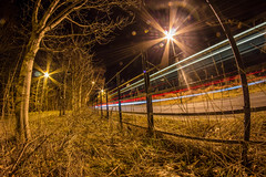Quiet road (chris.campbell97) Tags: road longexposure blue red tree cars night scotland fisheye perth lensflare