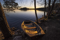 Golden hour (Kari Siren) Tags: wood light lake evening boat serene karijarvi