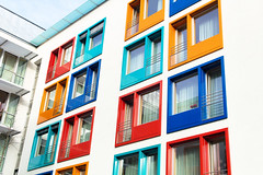 colorful facade of a modern apartment building, symbol of housing, rental, anonymity, city (caprightmarketing) Tags: city family urban house geometric modern facade studio living apartment flat sale townhouse space room capital cost large rental running neighborhood more similar repetition housing needs rent mass neighbor society residential investment occupied apartmentbuilding tenement owner additional realtor familyroom larger lease broker modernbuilding forrent tenant landlord anonymity similarity rented familyhouse lodger modernhouse largefamily urbancity residentialhouse neighborhoodhouses