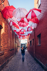 Umbrela Corp... (reivaxnc) Tags: red white girl sony 28mm australia lane ballarat umbrela a7ii
