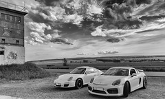 The difference between men and boys is the size of their toys (Simple_Sight) Tags: blackandwhite cars blackwhite noiretblanc 911 porsche cayman autos carrera sportscars gt4 sportwagen schwarzweis