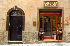 Italian food ... (Augusta Onida) Tags: door italy food shop cheese italia tuscany negozio porta pienza toscana formaggio pecorino bottega