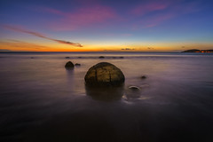 A Little Hint Of Pink (Arief Rasa) Tags: longexposure morning newzealand beach rock sunrise dawn coast waves outdoor tide boulders shore nz otago aotearoa hampden rockybeach moerakiboulders moeraki hightide sunriseandsunset