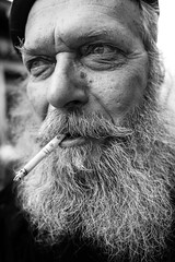 The artist and his beard (Giulio Magnifico) Tags: leica portrait man beard blackwhite artist cigarette 28mm streetphotography style smoker soulful summilux udine leicaq