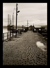 Rigs, fishing huts and Cobblestones (bigtalljohn) Tags: leica film hp5 ilford invernessshire m4p