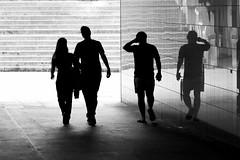 two by two (Wackelaugen) Tags: two four reflection people street silhouettes walk walking couple black white bw blackwhite blackandwhite mono canon eos photo photography wackelaugen googlies