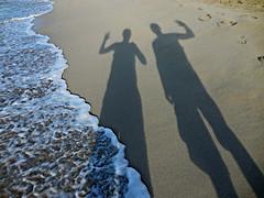 on the beach (kenjet) Tags: hello ocean shadow two hawaii sand waves shadows oahu pair sandy ken wave pacificocean shore waikikibeach waving kenny selfie kenjet
