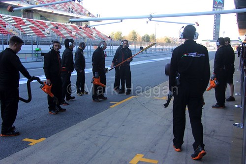 The Force India pit crew prepare to receive Nico Hulkenberg for a pit stop