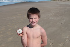 Issiah scores a sand dollar (rozoneill) Tags: oregon forest bay coast hiking dunes lakeside trail national area recreation winchester reedsport siuslaw dellenback wsweekly132