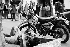 Cruel Reality (JinxBlow) Tags: people peru dark justice downtown lima police motorcycle reality tramp outcast