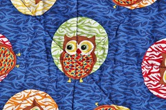 Bright Owl Quilt - Quilting (AluminumDryad) Tags: blue red green geometric floral yellow quilt turquoise sewing stripes knit polkadots fabric quilting stitching dots patchwork binding owls corners scrappy chevrons handstitching freepattern machinesewing disappearingninepatch firstquiltever obsessivelystitching