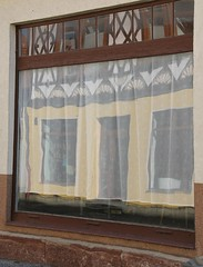 Reflections behind a curtain (:Linda:) Tags: house reflection abandoned window germany town curtain thuringia shopwindow rhomb historismus themar rocaille andreaskreuz historicism haltimbered