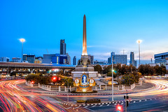 Victory Monument (akimesto) Tags: city longexposure travel bridge blue light sunset red sky urban colour building art monument skyline architecture night clouds zeiss photoshop wow landscape thailand twilight colorful asia long exposure flickr artist cityscape nightscape outdoor bangkok sony air fineart landmark victory structure infrastructure land a7 skycraper lightroom