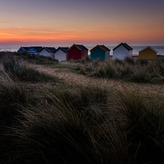Sunrise (hammermad) Tags: beach grass huts southwold beachhuts